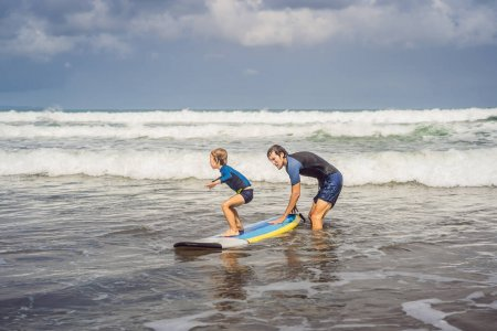 dad and kid surfing