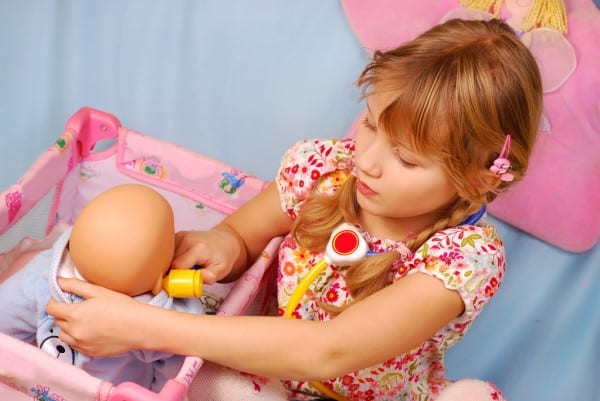 girl playing baby doll