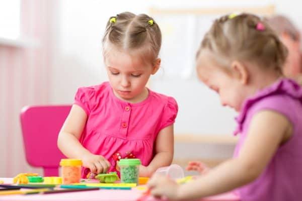 kids playing on art table